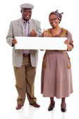 Elderly african couple holding blank banner — Stock Photo