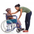 African woman comforting disabled senior grandmother — Stock Photo