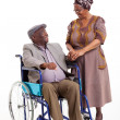 Senior african wife talking to handicapped husband — Foto de Stock