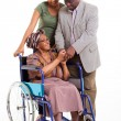 Disabled senior african woman with husband and granddaughter — Stock Photo #30761231