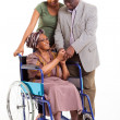 Disabled senior african woman with husband and granddaughter — Stock Photo