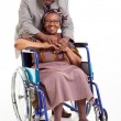 Disabled senior african woman and her caring husband — Stock Photo
