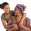 Stock Photo: African senior mother and adult daughter