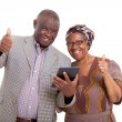 Senior african couple with tablet pc — Stock Photo