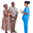 Young african medical nurse and elderly couple patient — Stok fotoğraf