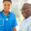 Senior african american man in doctors office — Stock Photo #30767551