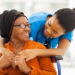 African senior patient with female nurse — Stock Photo #30767689