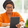 Senior african woman using tablet computer — Stock Photo #30769021