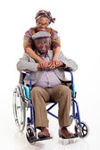 Loving african wife hugging disabled husband — Stock Photo
