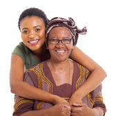 Pretty african daughter hugging senior mother — Stock Photo