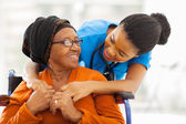 African senior patient with female nurse — Stock Photo