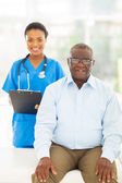 Senior afro american patient in doctors office — Stock Photo