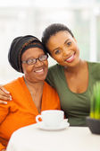 Senior african woman with daughter at home — Foto Stock