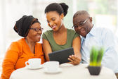 African family at home using tablet pc — Foto Stock