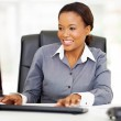 Young african american businesswoman working on computer — Stock Photo