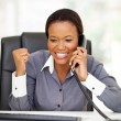 Stock Photo: Young africamericbusinesswomreceiving exciting news