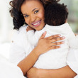 Young mother holding her baby in her arms — Stock Photo