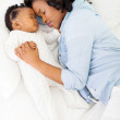 African american mother and her baby sleeping — Stock Photo #31139071