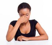 Stressed african businesswoman having headache — Stock Photo
