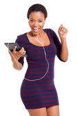 Young african woman listening to music — Stock Photo