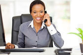 African american businesswoman using landline phone — Stock Photo