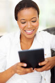 Young african american woman using tablet computer — Stock Photo