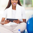African american woman holding tablet computer — Stock Photo