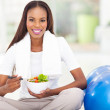 African woman eating healthy salad — Stock Photo #31971907