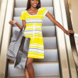 Shopping african woman using escalator — Stock Photo