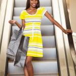 Shopping african woman using escalator — Stock Photo #31972913