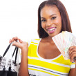 African woman holding a hand full of cash — Stock Photo