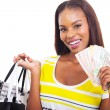 African woman holding a hand full of cash — Stock Photo #31973343