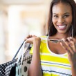 Cheerful african american woman shopping — Stock Photo