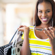 Cheerful african american woman shopping — Stock Photo #31974673