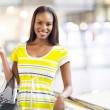 Stock Photo: African american woman in shopping mall