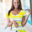 Happy african girl with shopping bags — Stok fotoğraf
