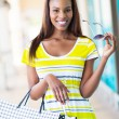 Happy african girl with shopping bags — Stockfoto