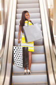 African woman shopping in mall — Stock Photo