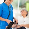 Medical doctor checking senior patient's blood pressure — Stock Photo #32146849