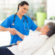 Stock Photo: Female doctor handshaking with patient