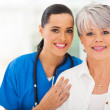 Middle aged woman and medical nurse — Foto Stock