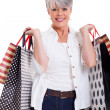 Senior woman with shopping bags — Foto de Stock