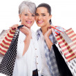 Mother and adult daughter carrying shopping bags — Stock Photo