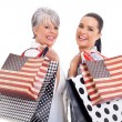 Middle aged woman with her daughter shopping — Stock Photo