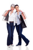 Senior mother and daughter holding shopping bags — Stock Photo