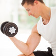 Young athlete lifting weights — Stock Photo
