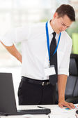 Businessman having lower back pain — Stockfoto