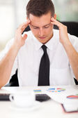 Stressful businessman at work — Stock Photo