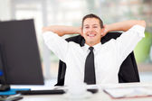 Young businessman relaxed in office — Stock Photo