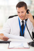 Businessman talking on landline phone — Stock Photo